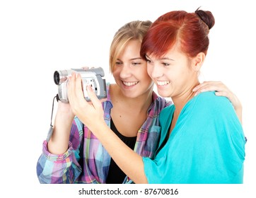 teenage girlfriend with video camera, white background