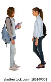 teenage girls with backpack and books