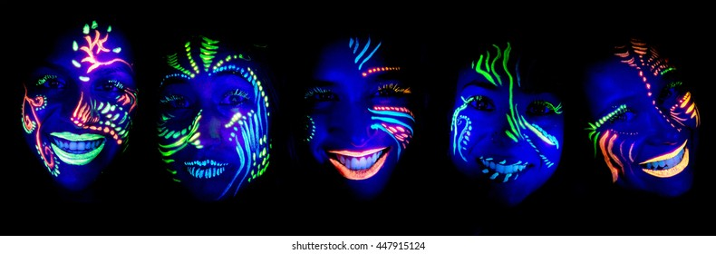 teenage girls with face painted under UV light