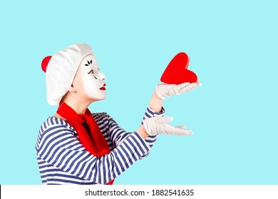 teenage girls in the image of mimes with makeup on their faces, isolate on a white background - Shutterstock ID 1882541635