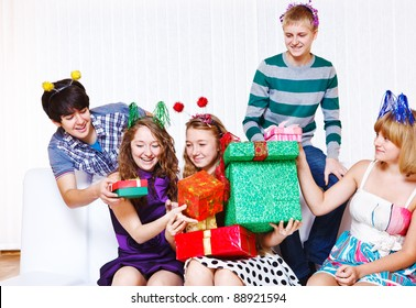 Teenage girls receiving holiday presents