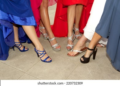 Teenage Girls showing off their shoes for the prom with just their legs and feet showing