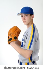 Teenage high school baseball player isolated against white background