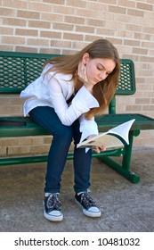 Teenage high school student studies before class
