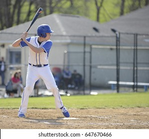 teenage highschool baseball batter