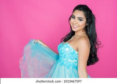 Teenage hispanic girl attending a dance in nice dress