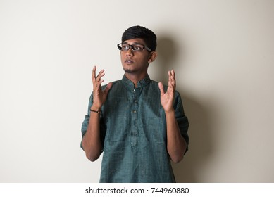 teenage indian male in traditional dress shouting