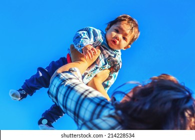 Teenage mother spending time with her 3 month old son at the park -- image taken at a park in Reno, Nevada