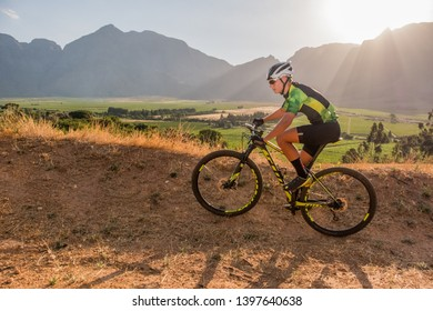 teenage mountain bike rider training on a summer evening for his next comeptition