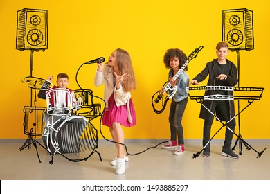 Teenage musicians with drawing instruments playing against color wall - Shutterstock ID 1493885297