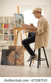 Teenage painter painting on a canvas in an art studio