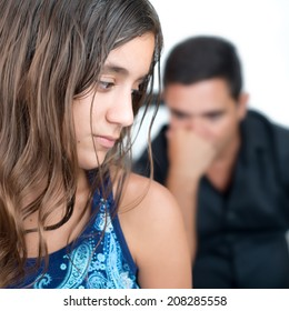 Teenage problems, teenage girl and her worried father at home