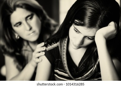 Teenage problems - Mother comforts her troubled teenage daughter