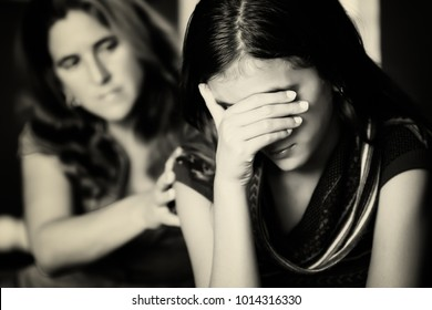 Teenage problems - Mother comforts her troubled teenage daughter who cries