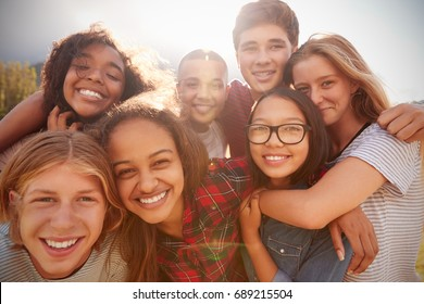 Teenage school friends smiling to camera, close up - Shutterstock ID 689215504