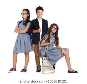 Teenage schoolchildren wearing uniform in a white studio