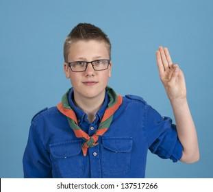 teenage scout boy making an oath