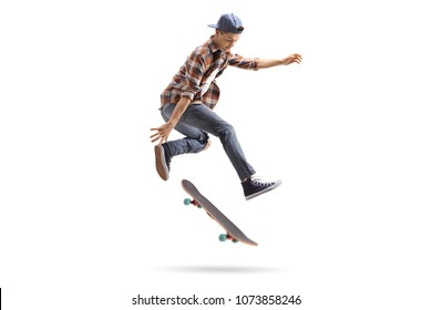 Teenage skater performing a trick with a skateboard isolated on white background