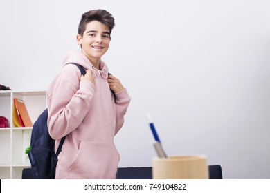 teenage student with school backpack smiling