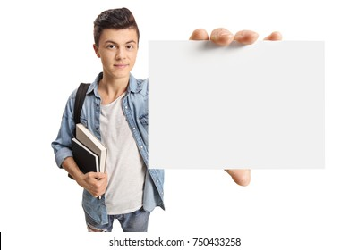 Teenage student showing a blank card isolated on white background