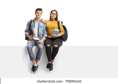 Teenage students sitting on a panel isolated on white background