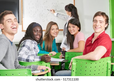 Teenage students smile in their math class at school