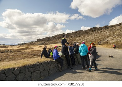 Teenage students standing or sitting during a visit to the Thingvellir Rift Valley, Golden Circle area, Iceland, May 21, 2016