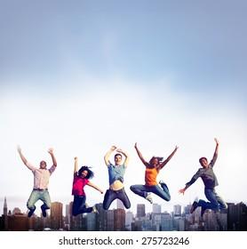 Teenage Success Team Jumping Cheerful Concept