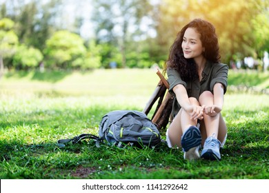Teenage tourists have cheerful feeling to have rest in the forest. During long weekend of summer This make the stress in everyday life well. Depression is better. Make more positive thinking with life