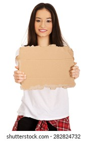 Teenage woman holding empty cardboard.