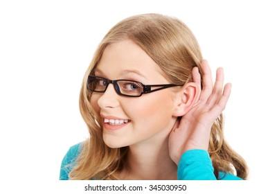 Teenage woman overhears a conversation