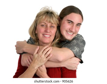 A teen-aged boy and his mother posing for a portrait.