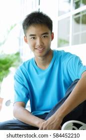 Teenaged boy looking at camera, smiling
