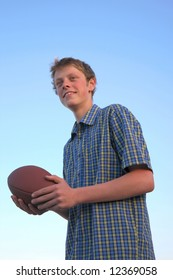 Teenager with an American football