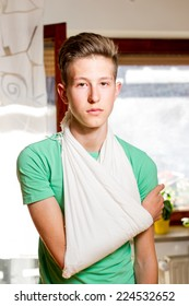 Teenager with arm in a sling.