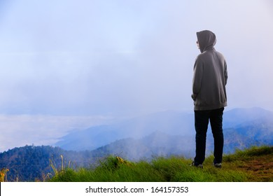 Teenager asian boy standing at mountain, Outdoor portrait