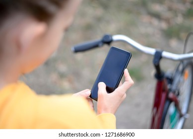 teenager with bicycle and smartphone