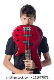 Teenager boy behind bass guitar, isolated on white