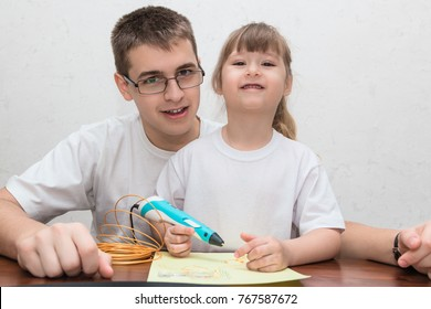 Teenager boy and cute little girl draw different things by 3d pen with a gold plastic handle. Mathematics. Engineering. Technology. Robotics. STEM education.