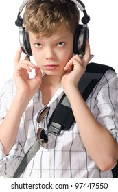 teenager boy is listening for music on white background