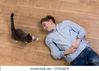 teenager boy playing with his cat