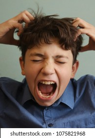 teenager boy scratching head itch because of lice