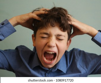 teenager boy scratching head itch because of lice close up photo