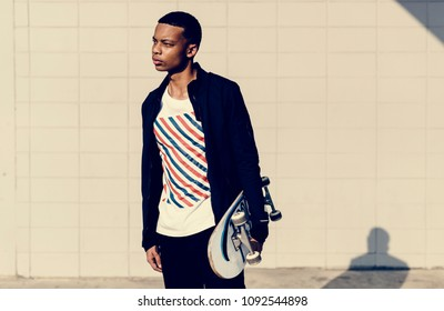 Teenager boy with a skateboard