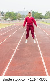 Teenager boy wear red sport cloth run on racetrack, jumping and exercise for health. Healthcare and sport concept. Free space for your text.