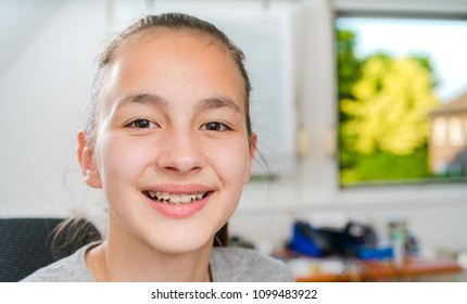 Teenager with braces on her teeth