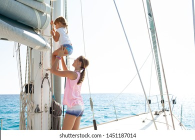 Teenager and child sisters on private luxury sailing yacht summer holiday help climb mast, adventure travel, beautiful family outdoors. Fun girls expedition leisure recreation aspirational lifestyle.