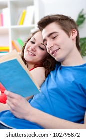 Teenager couple reading book together