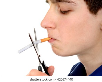 Teenager cutting a Cigarette with Scissors Closeup on the White Background