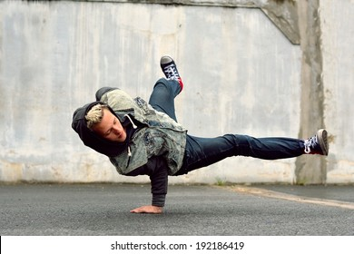 Teenager dancing breakdance in the street